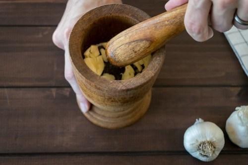 mashing the garlic and salt