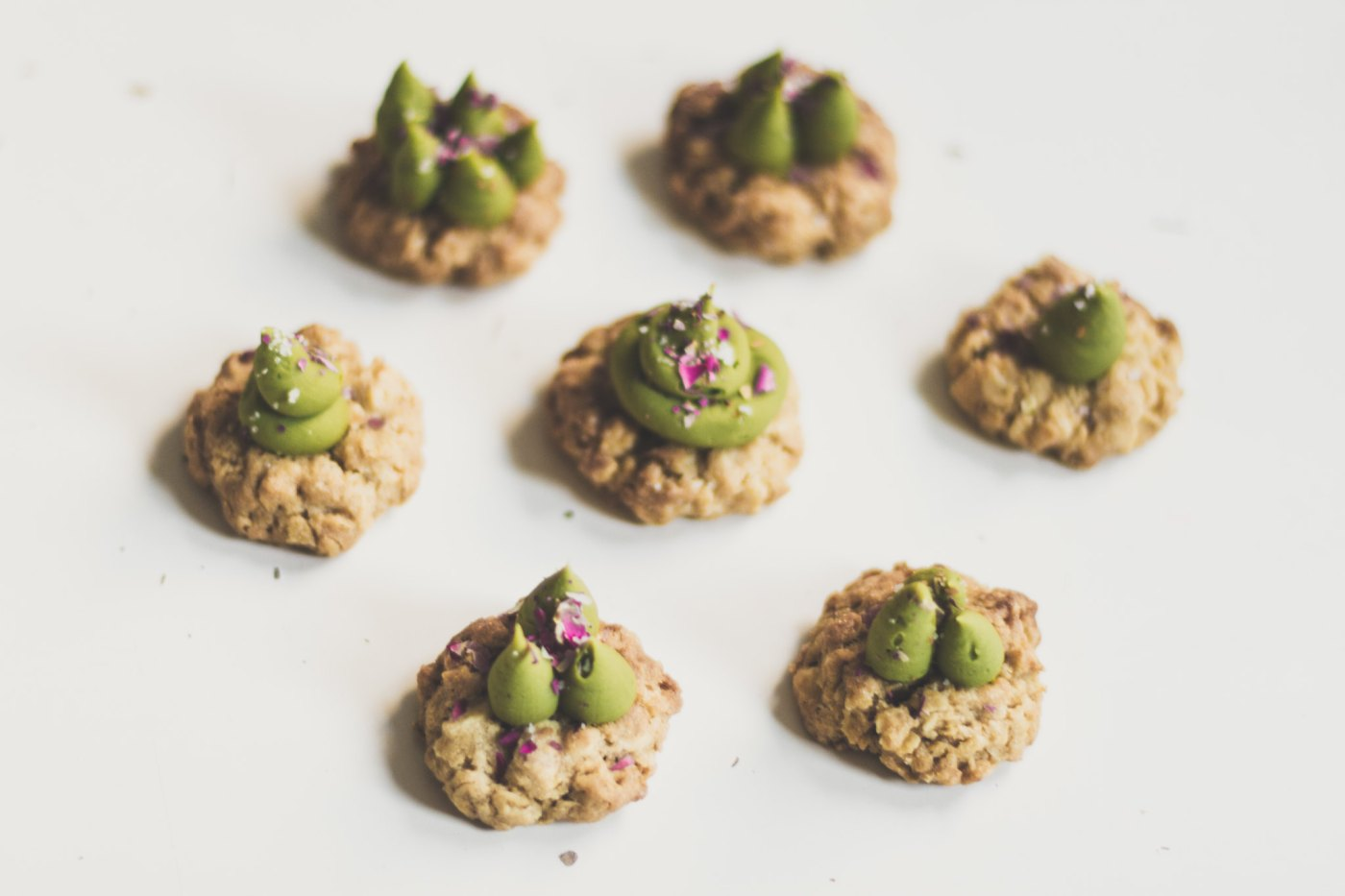 salted oatmeal rose cookies with white chocolate and matcha ganache