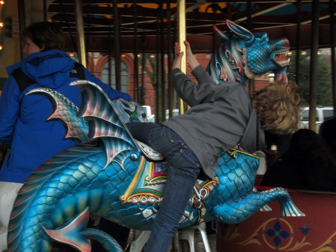 Riding the carousel dragon