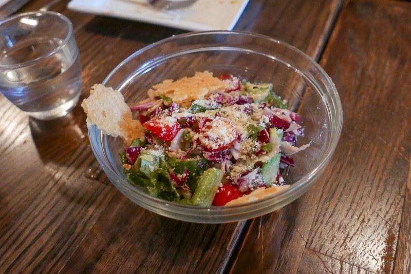 Insalata Mista - Mixed greens, tomato, cucumber, olive vinaigrette, crispy parmesan