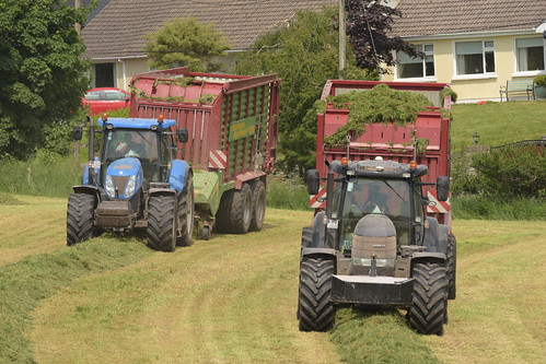 Case & New Holland Tractors with Struatmann Silage Wagons