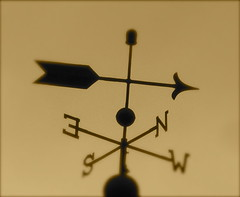a weather vane points NW