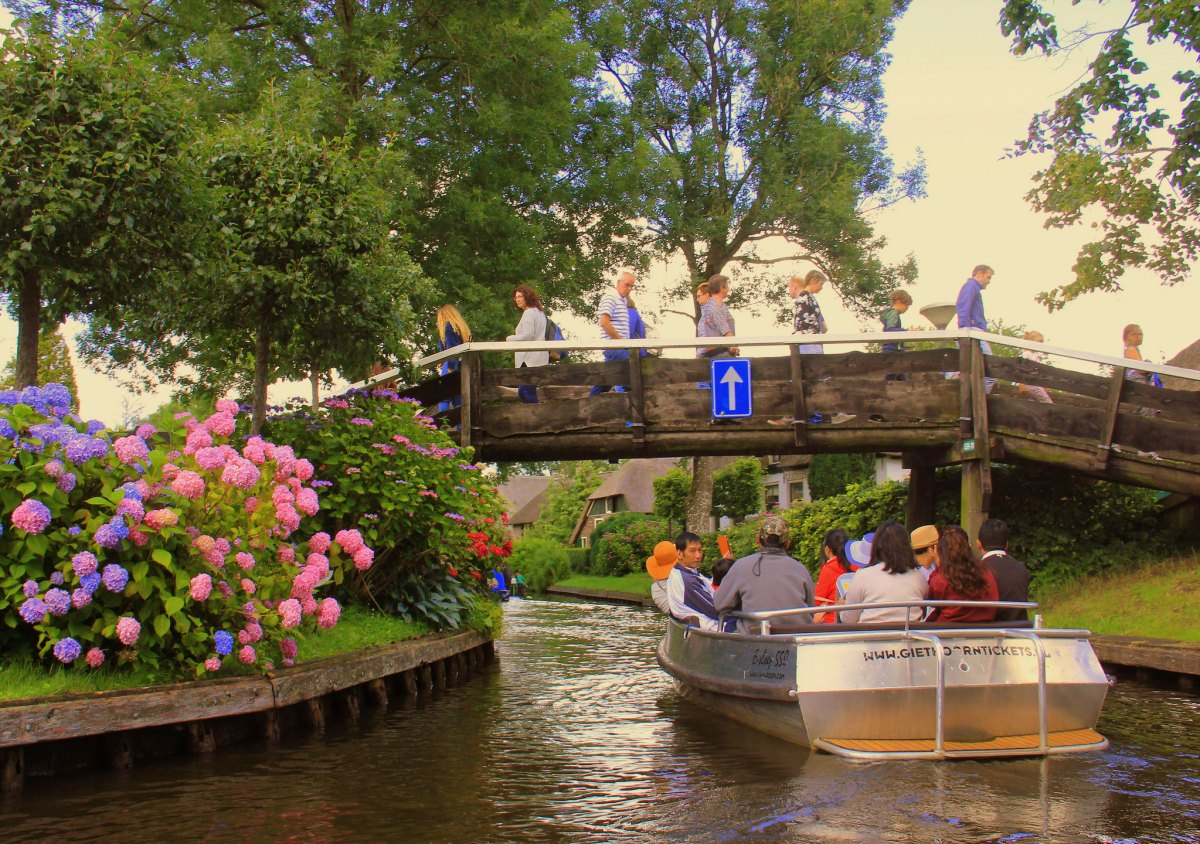 Tourists boats floating down Giethoorn