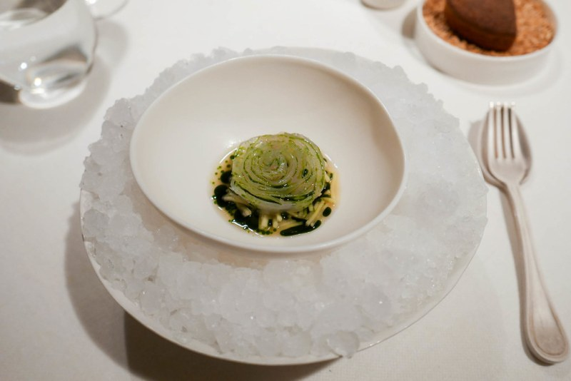 HOMAGE Roses, sealace, cabbage, dill, pike-perch. The fish is cured in salt and sugar, then cold-smoked. The juice is made of white carrots, rhubarb, dill and sealace with fermented barley grains.