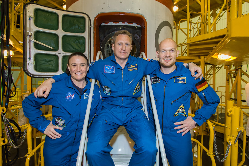 Expedition 56 crew members in front of the Soyuz spacecraft