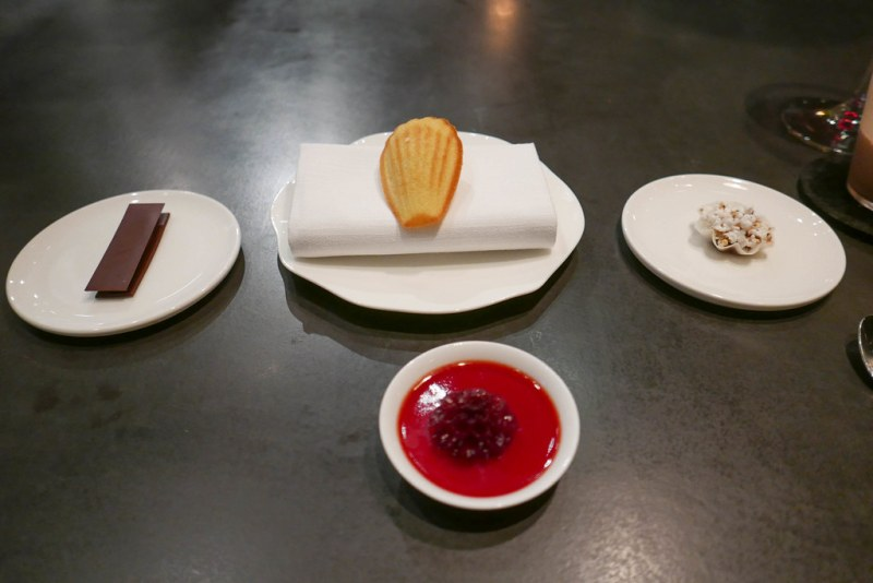 1) Miso Caramel, Chocolate 2) Madeleine, Black Garlic Ganache 3) Sorghum, Peanut 4) White Chocolate, Black Currant