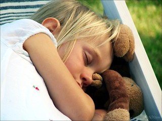 sleeping girl in a garden (berlin, germany)