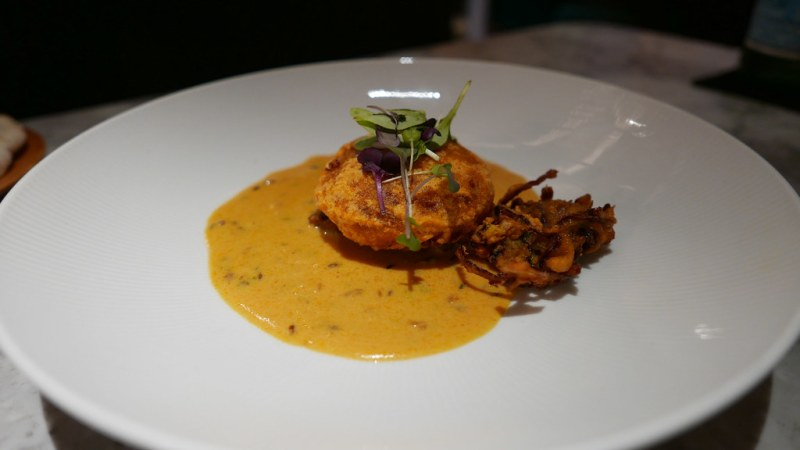 Chicken kofta, Punjabi kadi, onion pakora. parmesan yogurt, tamarind mint sauce, crispy potato $21