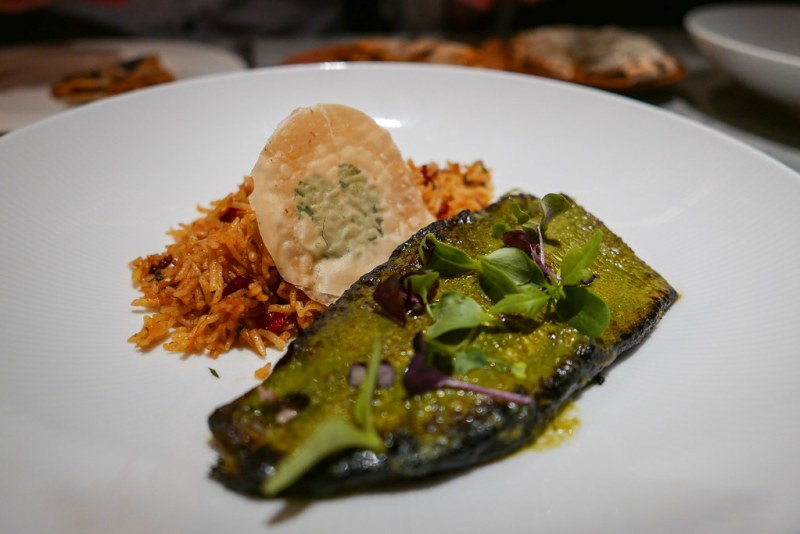 Baked sea bass is wrapped in the green patrani leaf then pan fried. The pulao berry is quite rare and found in northern India. Baked Sea Bass, Patrani Butter, Berry Pulao $21