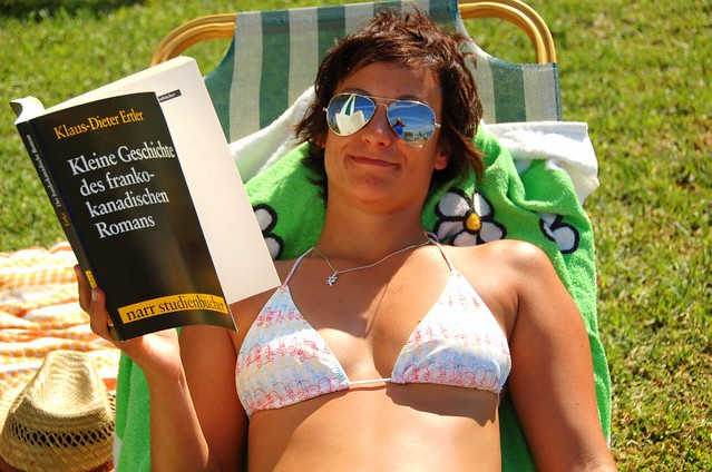 Girl reading a German book while sun bathing