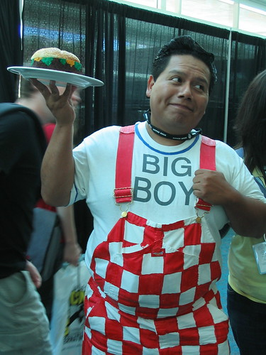 Big Boy holding a faux burger