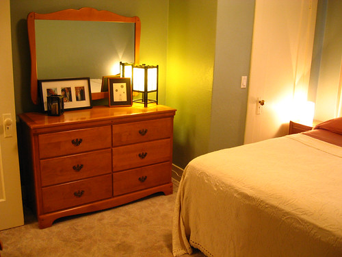 The orange color kind of matches the dresser.