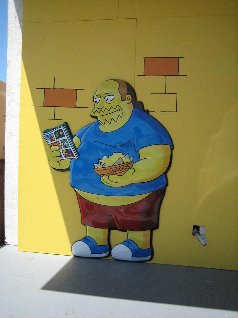 Simpsons comic store guy outside kwik e mart