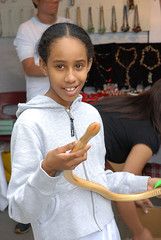 young girl buying a snake