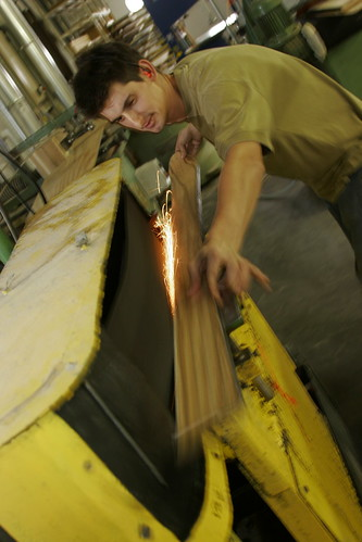 Cutting the edges for a pair of Boheme skis.