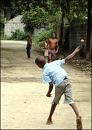 Dominican children playing baseball