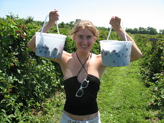 lauren hoists two buckets full of clackberries above her head