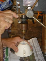 drilling the hole in the tea cup