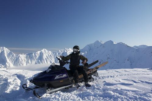 Graham modeling his sled, vest and homemade skis