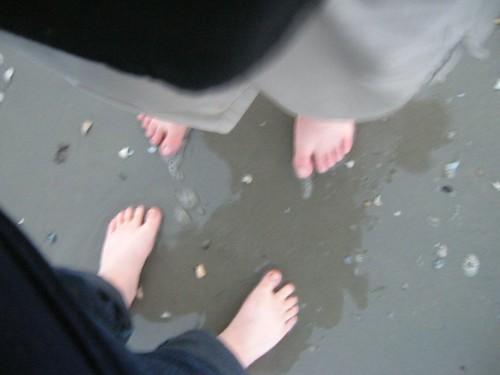 Dan's feet, my feet, sand.