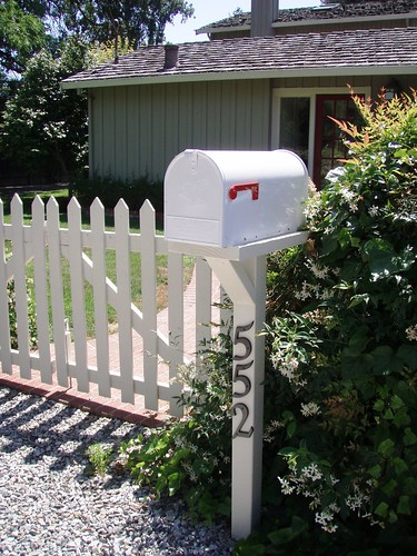 white picket fence and mailbox