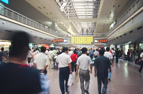 People rush through the terminal vying for their place in line and hoping they did not miss their train.