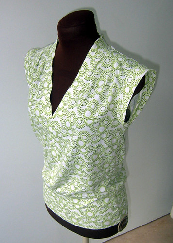 white knit top with green circle swirls