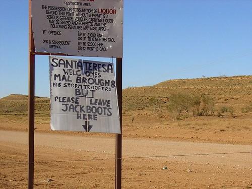 Santa Teresa township sign - Leave jackboots here