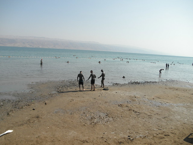Dead Sea - People applying the medicinal mud and floating with ease