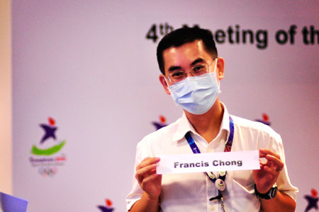 Dr Francis Chong covers up to prevent any spreading of germs