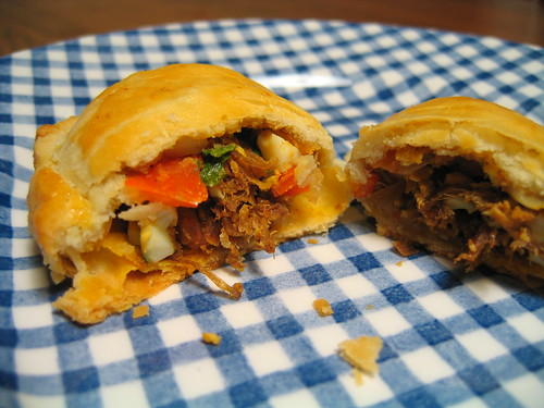 romesco pulled pork turnover with peppers & egg (cut)