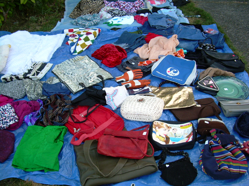Our yard sale: close-up of clothes-and-purse-land