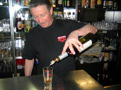 Michel pours his pastis with a punch