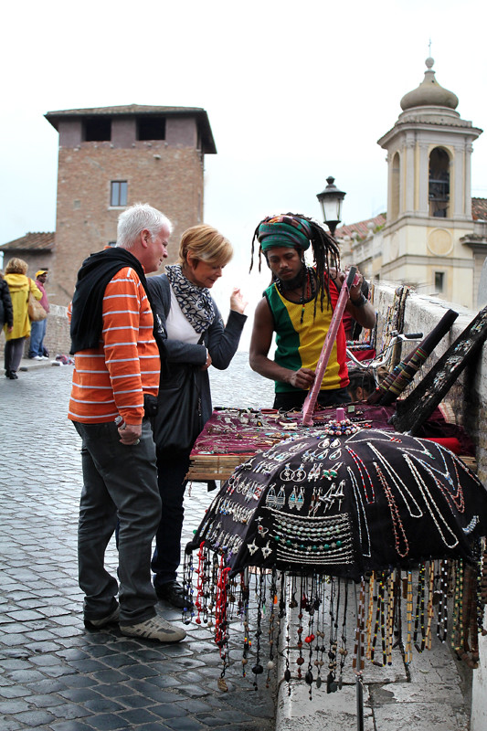 A street vendor and two tourists