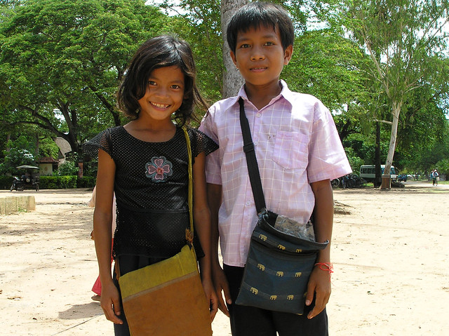 Kids selling postcards and bracelets outside Angkor Wat