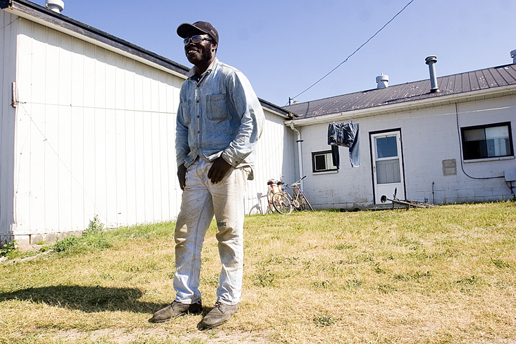 Shirley Wright outside his Canadian home at the Strawberry Place.