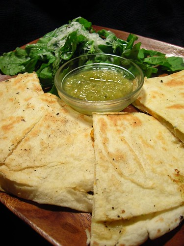 Quesadillas served with arugala salad and extra sauce for dipping