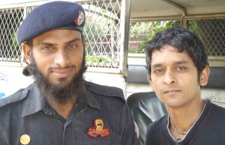 The author with a Pakistani cop in Lahore