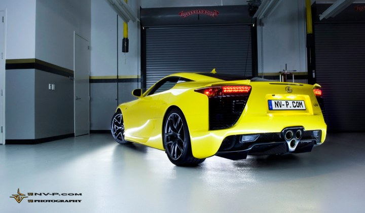 yellow Lexus LFA facing out of the training center