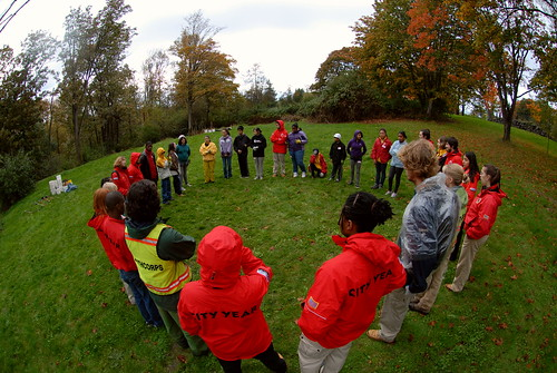 The team and volunteers circle before the start of service.