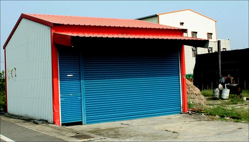 red roofed shed with blue gate