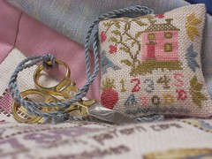 Blackbird Designs Pink House stitched over one