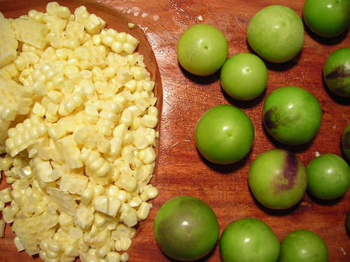 Peeled tomatillos and corn kernnels