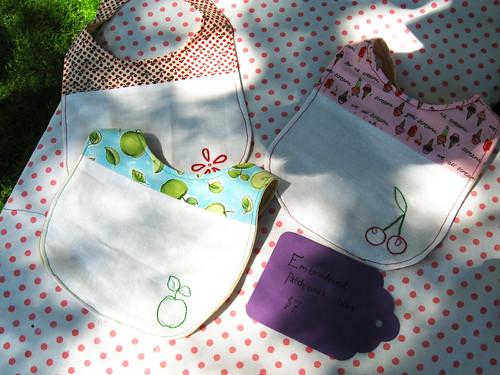 Embroidered bibs by Mackenzie.