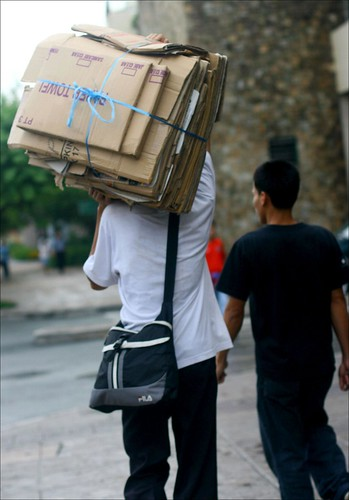carrying flattened cardboard boxes