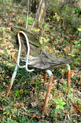 one of an entire series of dilapidated chairs in the woods
