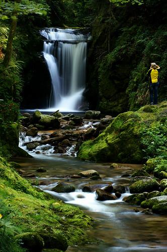 woman in yellow @ a waterfall