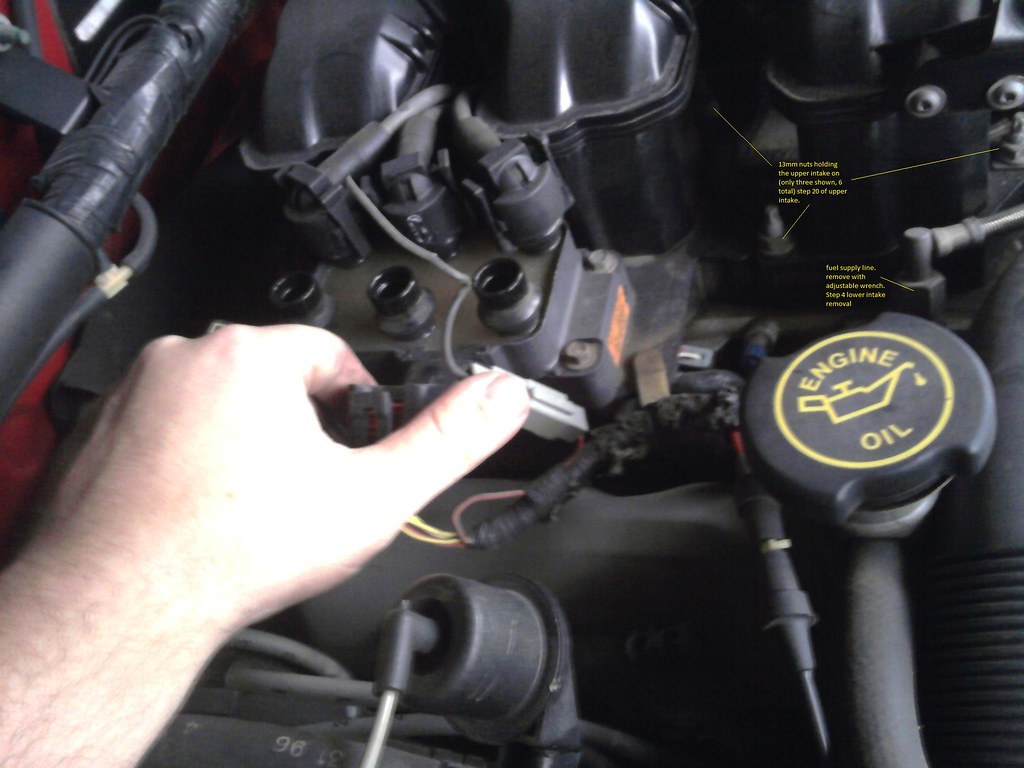 hight resolution of you don t want to damage any sensors or the pcm 2 remove the rubber hose that connects the oil fill neck on the passenger side valve cover