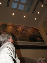 Woodward observes his artwork after installation is complete.