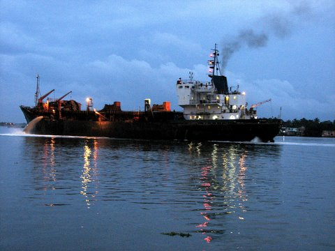 ship moving into harbour at dusk kochi 260807
